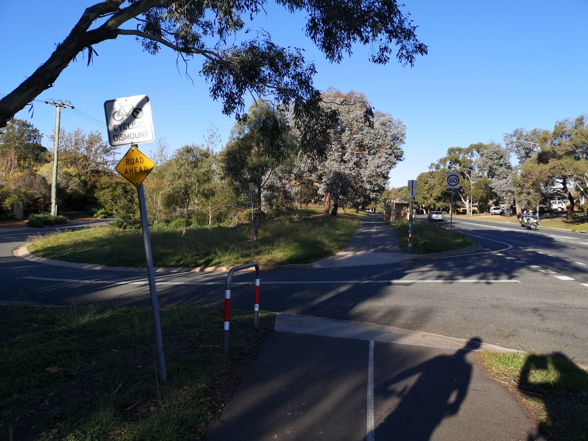 """The sign """"Cyclist Dismount"""" is not correct. Safe cycling requires """"continuous verge treatment"""", Southern Cross Drive, Macgregor"""