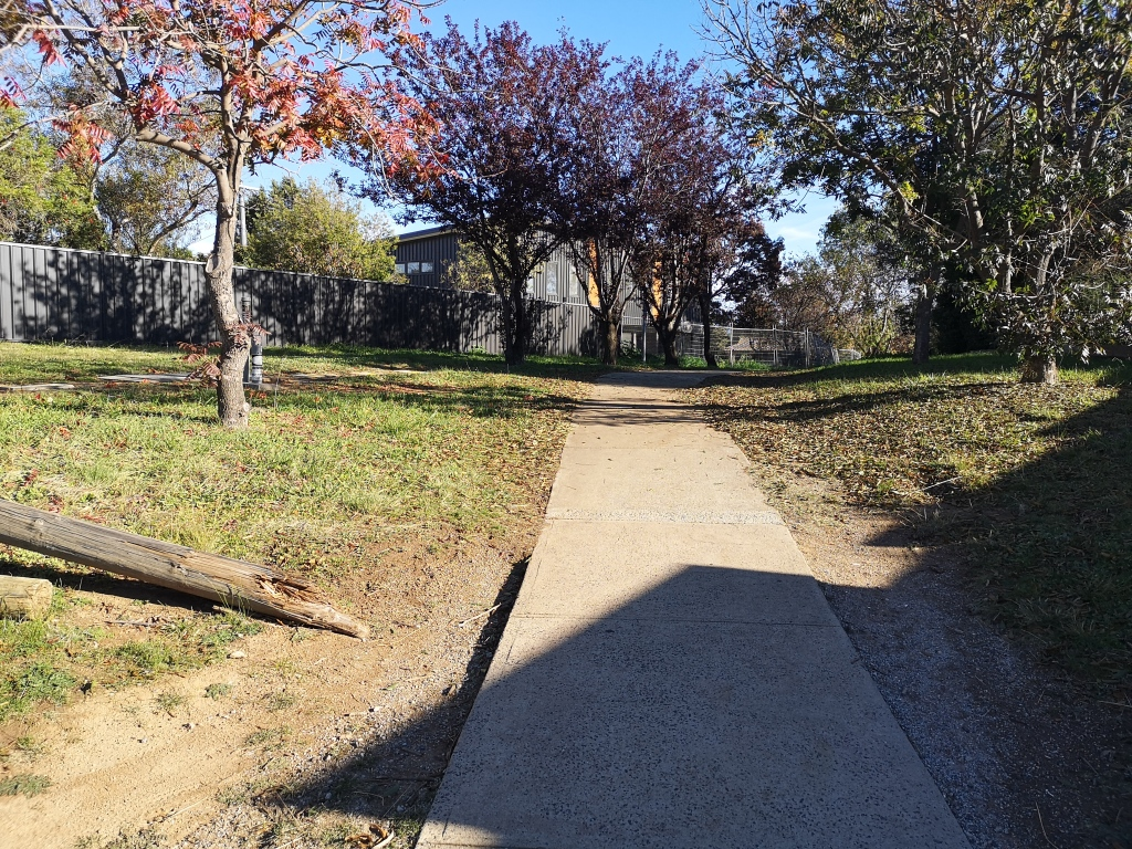 Community paths around Evatt local shops, Belconnen. In older suburbs, the gradients are often more than one would like. Steep paths and ramps are not consistent with active travel standards and ACT Disability Act.