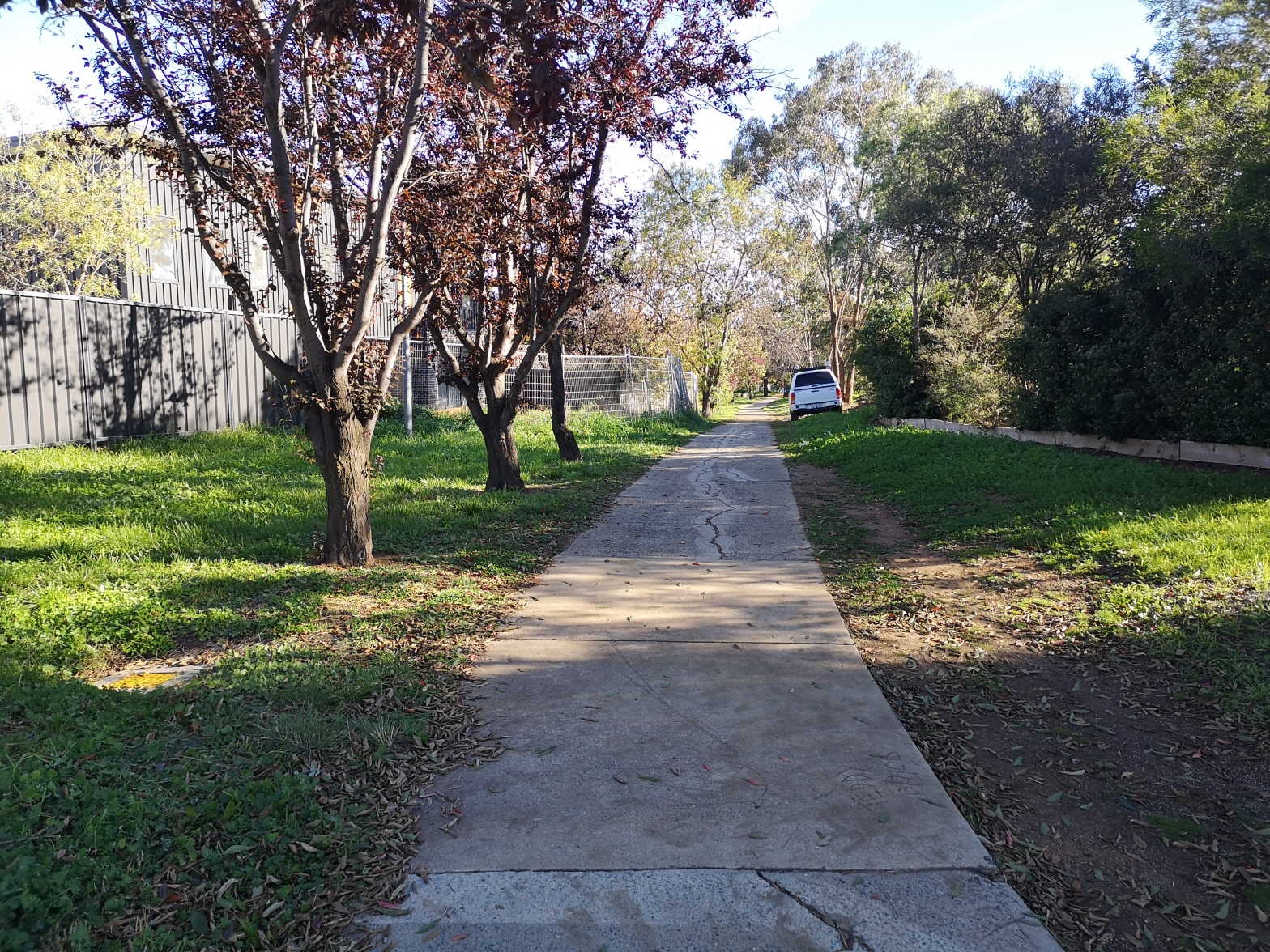 The path is safe but old. At some point, this path will need replacing. Community paths around Evatt local shops, Belconnen