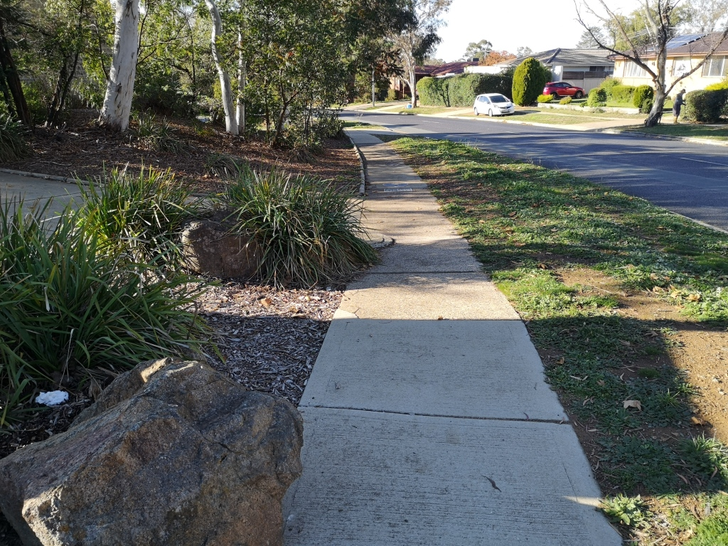 Community path in Evatt, Belconnen. There should be 0.5m clearance of obstacles for it to be safe for the cyclist according to ACT standards. The proximity of the bollard could be fixed