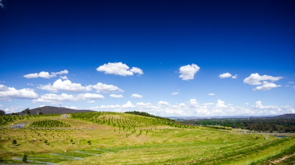 National Arboretum, clouds, sky, and hills, Canberra . Photo by Tim Cooper on Unsplash