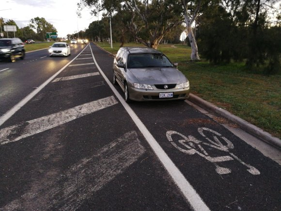 False parked on an on-road bike lane, Higgins dual carriageway roundabout, Kingsford Smith Drive, between the suburbs of Higgins, Hawker and Scullin, Belconnen, Canberra