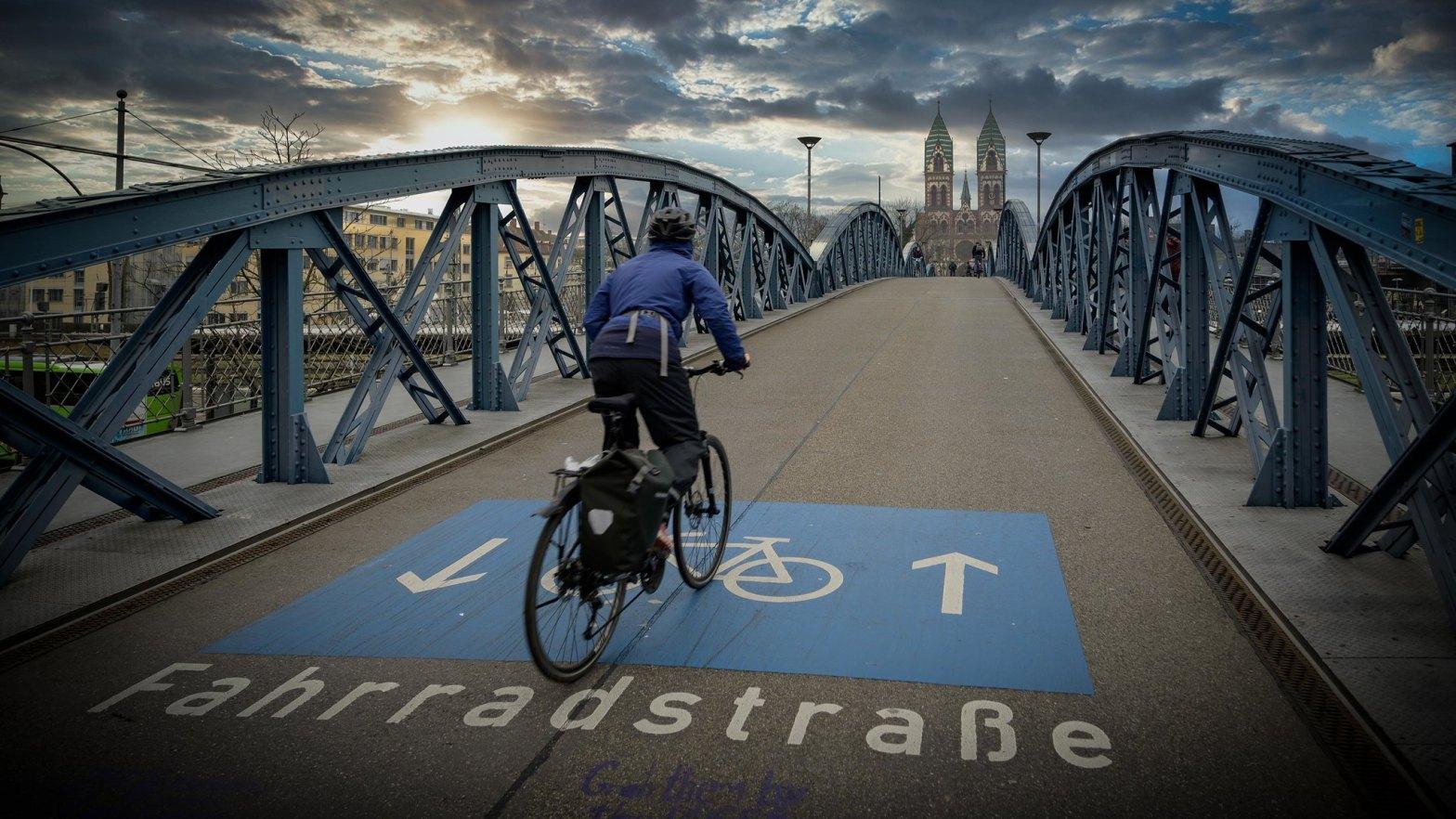Bike street (Fahrradstraße). Bike path crossing bridge over the railway station in Freiburg (im Breisgau), Southern Germany.