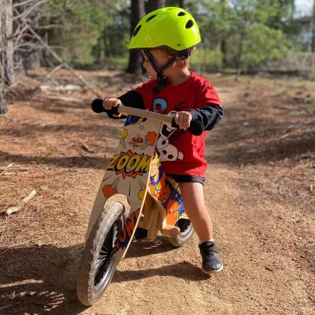 boy on a training bike