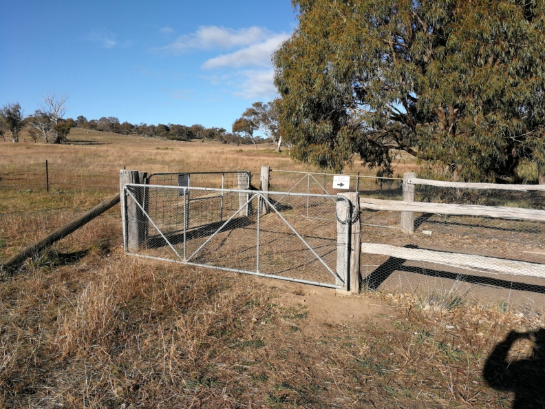 """Open me"" car park gate at the southern entrance to The Pinnacle Offset Area, The Pinnacle, Belconnen"