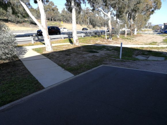 Example of the failure to build a path on the preferred line. Flemington Road, Mitchell, Canberra.