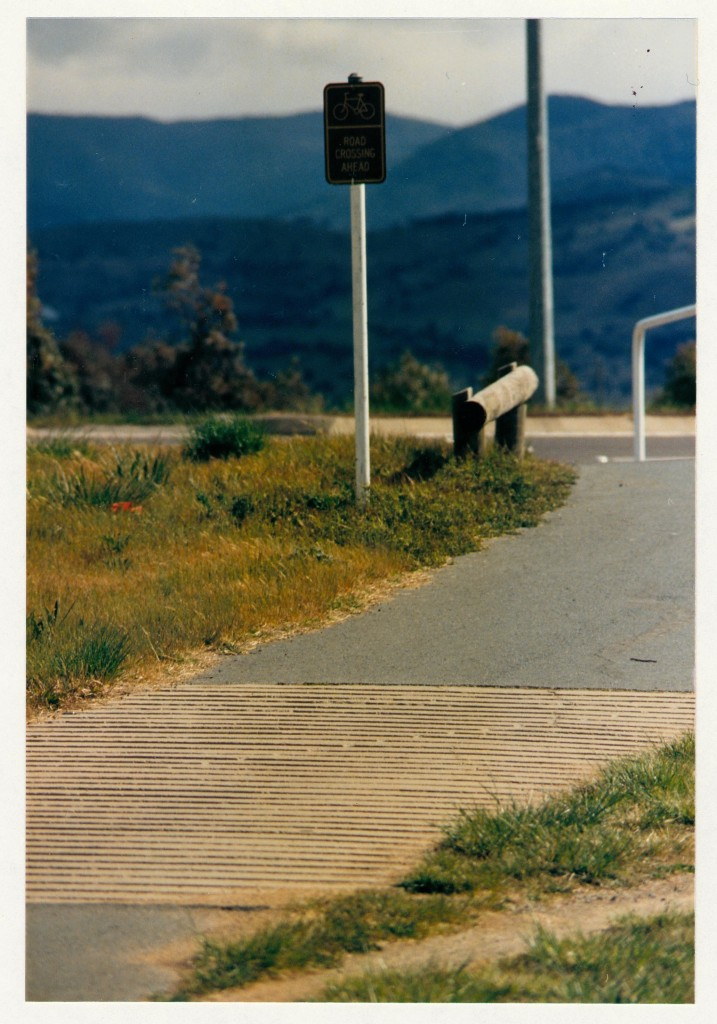 Approach to Sulwood Drive crossing showing warning sign and ripple strip. c1989