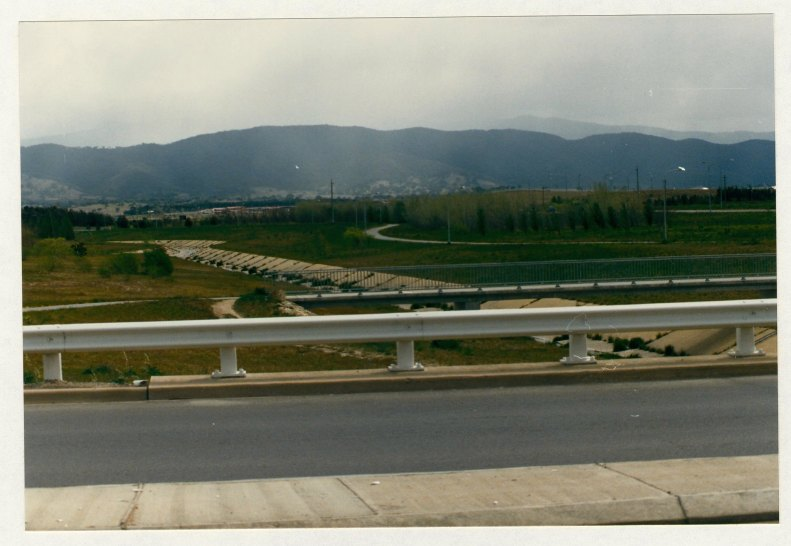 Pathway bridge linking opposite sides of stormwater drain adjacent to Ashley Drive. c1989