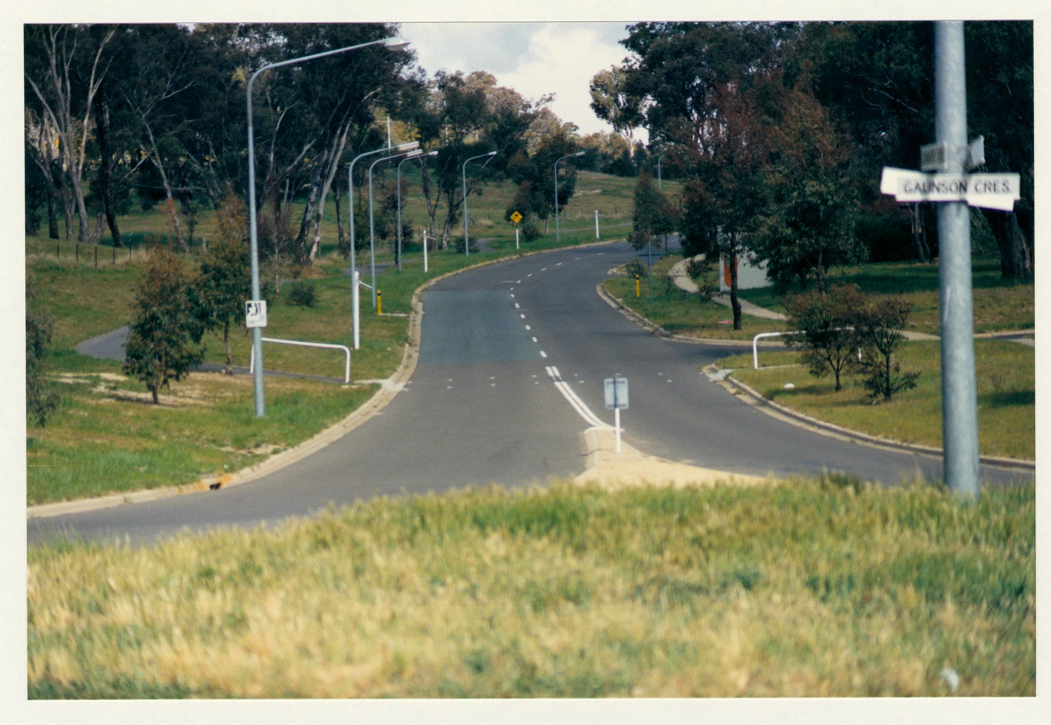 Pathway crossing Longmore Crescent at Gaunson Crescent. View from roadway centre. c1989